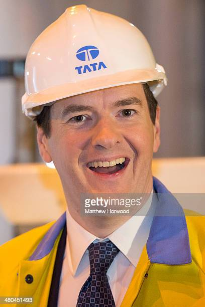 Chancellor George Osborne smiles during a visit to Tata Steel to see how it has been affected by the budget on March 25 2014 in Port Talbot Wales In...
