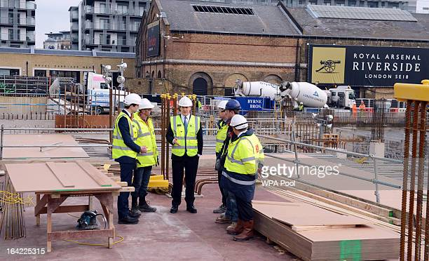 Chancellor George Osborne speaks to construction workers at the Berkeley Homes Royal Arsenal Riverside development in Woolwich on March 21 2013 in...
