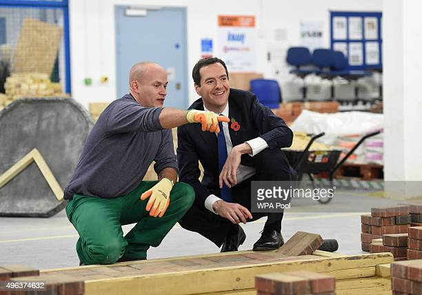 Chancellor George Osborne speaks with prisoner Jason Locke during a visit to Brixton Prison on November 09 2015 in London England The Government has...