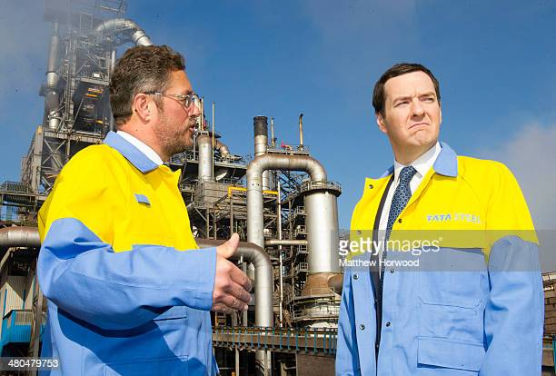 Chancellor George Osborne with CEO of Tata Steel Europe Karl Koehler during a visit to Tata Steel to see how it has been affected by the budget on...