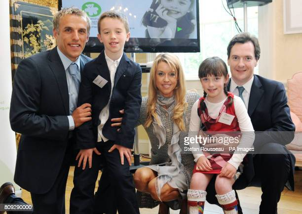 Chancellor George Osborne with Everton footballer Phil Neville his wife Julie and their children Isabella and Harvey at an event to raise money for...