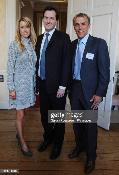Chancellor George Osborne with Everton footballer Phil Neville his wife Julie at an event to raise money for the Royal Manchester Children's Hospital...
