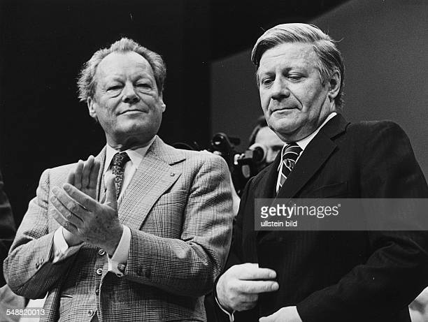 Chancellor Helmut Schmidt right and SPD party leader Willy Brandt during a SPD convention in Hamburg 1977