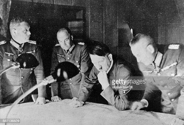 ADOLF HITLER Chancellor of Germany 193345 Hitler at his headquarters in East Prussia with Generals Wilhem Keitel Walther von Brauchitsch and Franz...