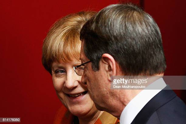 Chancellor of Germany Angela Merkel and Prime Minister of Cyprus Nicos Anastasiades speak during the family photo call at The European Council...