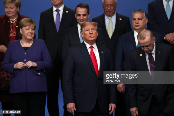Chancellor of Germany Angela Merkel and US President Donald Trump stand onstage during the annual NATO heads of government summit on December 4 2019...