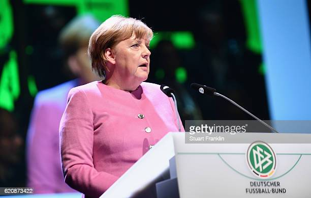 Chancellor of Germany Angela Merkel holds a laudatory speech for the former head coach of the German National and current head coach of the US Soccer...