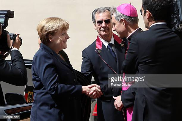 Chancellor of Germany Angela Merkel is received by Prefect of the Pontifical House and former personal secretary of Pope Benedict XVI Georg Ganswein...