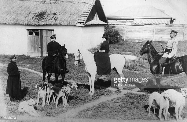 Chancellor of Germany Prince Otto von Bismarck seated on his horse with a pack of hounds during a hunt