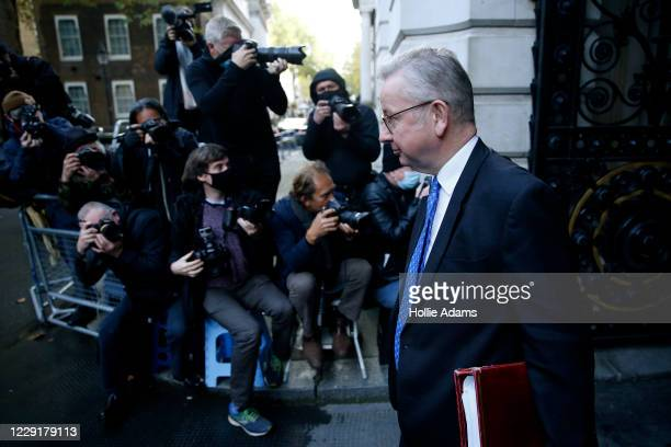 Chancellor of the Duchy of Lancaster Michael Gove returns to Downing Street after attending the weekly cabinet meeting on October 20 2020 in London...