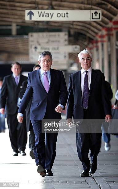 Chancellor of the Exchequer Alistair Darling and Prime Minister Gordon Brown walk to a train on April 13 2010 in Nottingham England The General...
