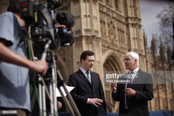 Chancellor of the Exchequer Alistair Darling debates with his Conservative shadow George Osborne in a BBC news television interview near Parliament...