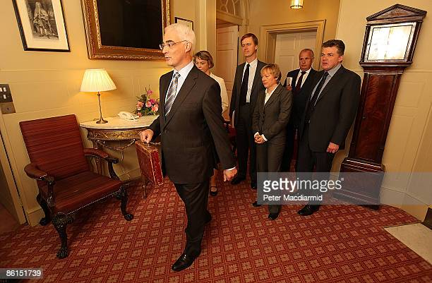Chancellor of the Exchequer Alistair Darling holds Disraeli's original budget box as he stands with his treasury team inside number 11 Downing Street...