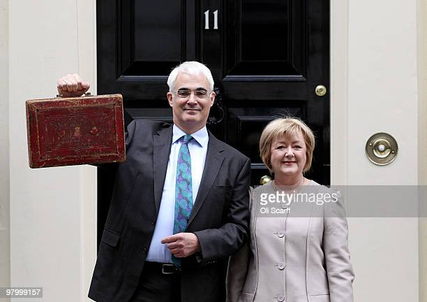 Chancellor of the Exchequer Alistair Darling holds Disraeli's original budget box next to his wife Maggie Darling outside number 11 Downing Street on...