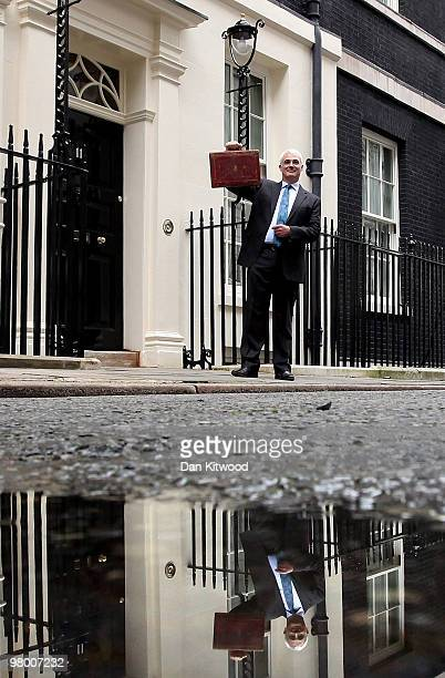 Chancellor of the Exchequer Alistair Darling holds Disraeli's original Budget box outside number 11 Downing Street on March 24 2010 in London England...
