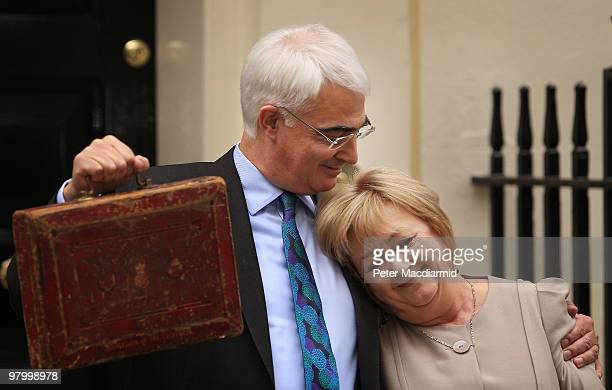 Chancellor of the Exchequer Alistair Darling hugs his wife Maggie outside number 11 Downing Street on March 24 2010 in London England In Parliament...