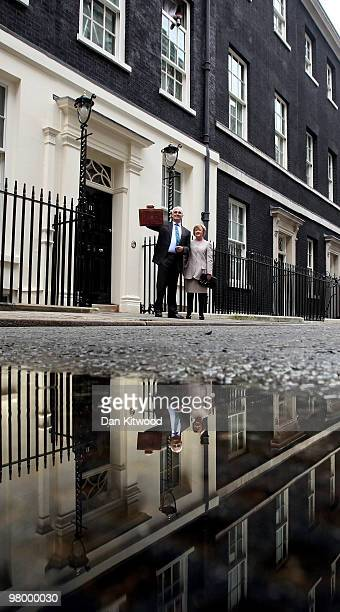 Chancellor of the Exchequer Alistair Darling stands with his wife Maggie outside number 11 Downing Street on March 24 2010 in London England In...