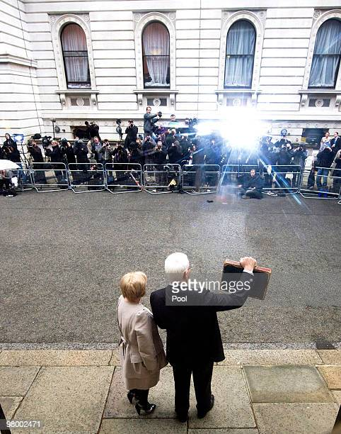 Chancellor of the Exchequer Alistair Darling stands with his wife Margaret Darling as he holds the Gladstone dispatch box containing the 2010 budget...