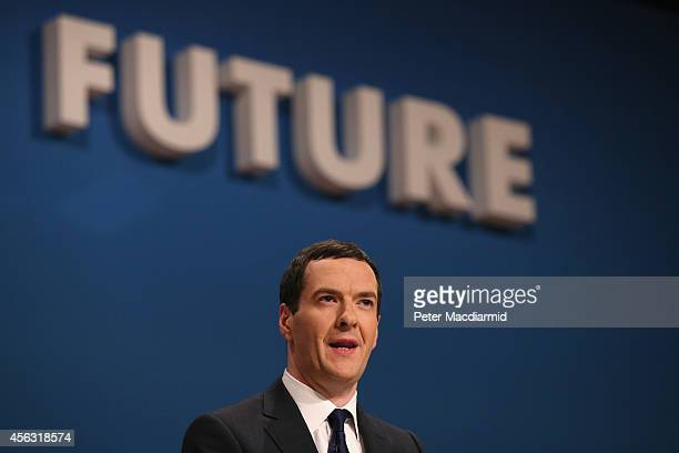 Chancellor of the Exchequer George Osborne addresses the Conservative party conference on September 29 2014 in Birmingham England The second day of...