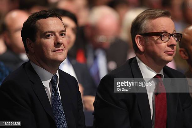 Chancellor of the Exchequer George Osborne and Michael Gove the Secretary of State for Education listen to speeches in the Main Hall of Manchester...