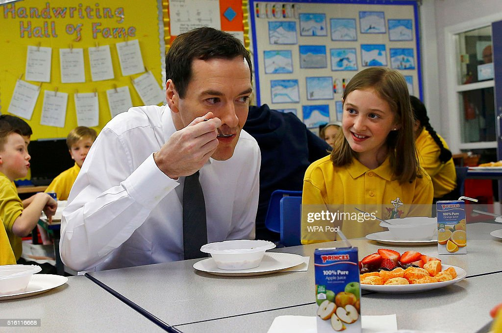 Chancellor of the Exchequer George Osborne eats with pupils during breakfast club at St Benedict's Catholic Primary School on March 17, 2016 in Garforth, United Kingdom. The Chancellor announced in his Budget speech yesterday that all schools in England will become academies by 2020.