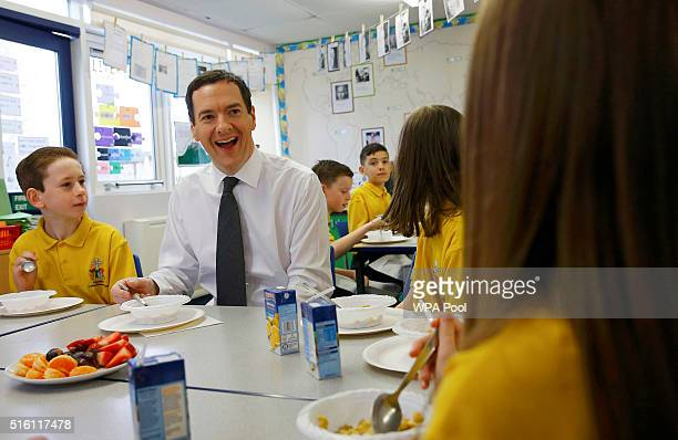 Chancellor of the Exchequer George Osborne eats with pupils during breakfast club at St Benedict's Catholic Primary School on March 17 2016 in...