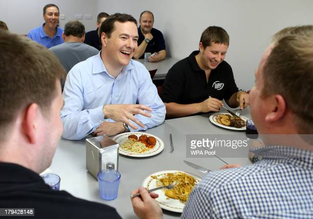 Chancellor of the Exchequer George Osborne enjoys lunch with workers during a visit at the Montrose Platform in the North Sea where he later joined...