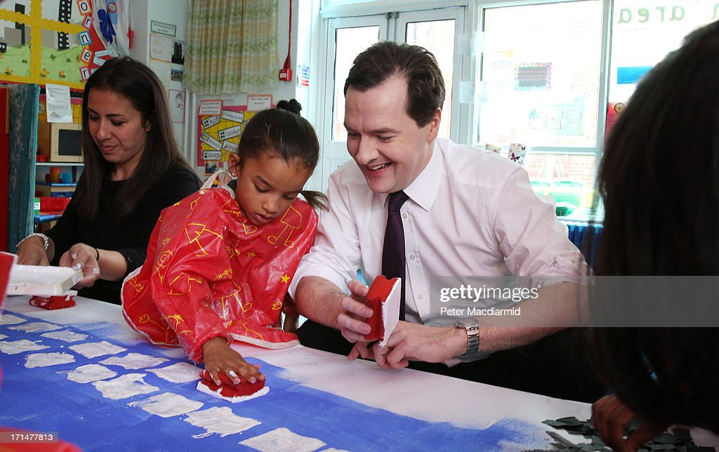 Chancellor of the Exchequer George Osborne helps paint a picture of Canary Wharf during a visit to Old Ford Primary School on June 25, 2013 in London, England. Tomorrow Mr Osborne will announce the Government's spending review for 2015-1016. Earlier the Chancellor announced that spending on schools will be ring fenced.