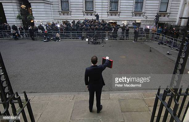 Chancellor of the Exchequer George Osborne holds his ministerial red box up to photographers as he stands outside number11 Downing Street on March 18...