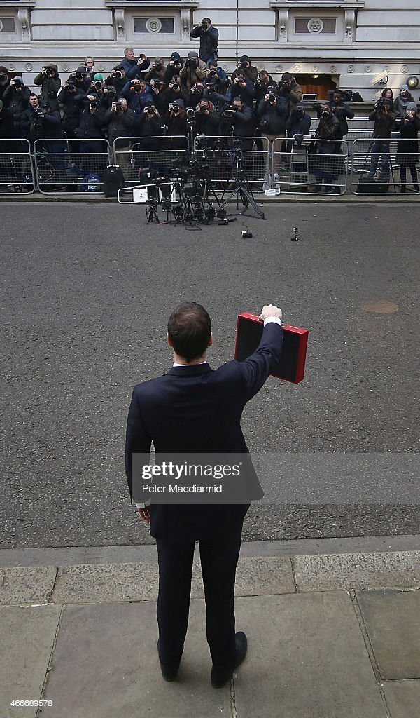 Chancellor of the Exchequer George Osborne holds his ministerial red box up to photographers as he stands outside number11 Downing Street on March 18, 2015 in London, England. The Chancellor is presenting his 5th Budget to Members of Parliament today, the last before the General Election on May 7, 2015.