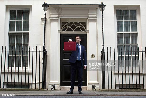 Chancellor of the Exchequer George Osborne holds his ministerial red box up to the media as he leaves 11 Downing Street on March 16 2016 in London...