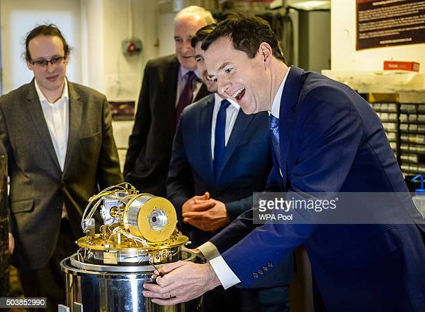 Chancellor of the Exchequer George Osborne inspects a cooling and imaging device designed for space exploration during his visit to the Cardiff...