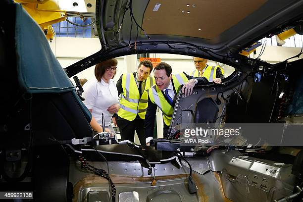 Chancellor of the Exchequer George Osborne is given a tour of the production line at Bentley Motors on December 4 2014 in Crewe England The...