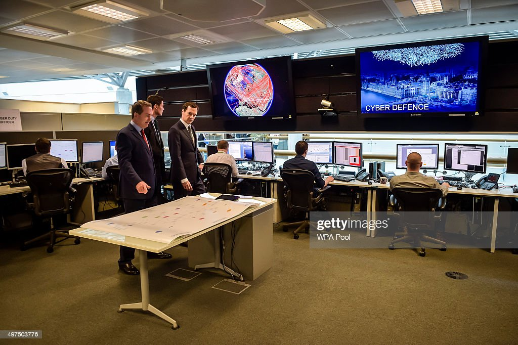 Chancellor of the Exchequer George Osborne is shown the 24 hour Operations Room inside GCHQ, Cheltenham by the Director of GCHQ Robert Hannigan (L) and Cheltenham MP Alex Chalk (C) on November 17, 2015 in Cheltenham, England. Chancellor George Osborne delivered a speech in which he stated that Britain has developed an 'offensive cyber capability' to hit back directly at terrorists and states, as he warned Islamic State was seeking to launch potentially deadly attacks on UK targets.