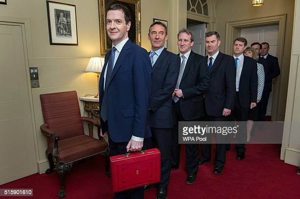 Chancellor of the Exchequer George Osborne leaves 11 Downing Street with his treasury team Lord O'Neill Damian Hinds David Gauke Chris Skidmore...