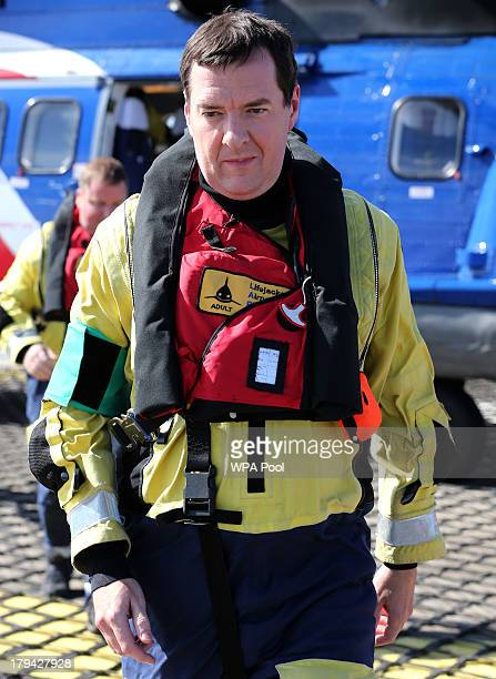 Chancellor of the Exchequer George Osborne leaves a Bristow A332L helicopter after arriving on the Montrose Platform in the North Sea where he later...