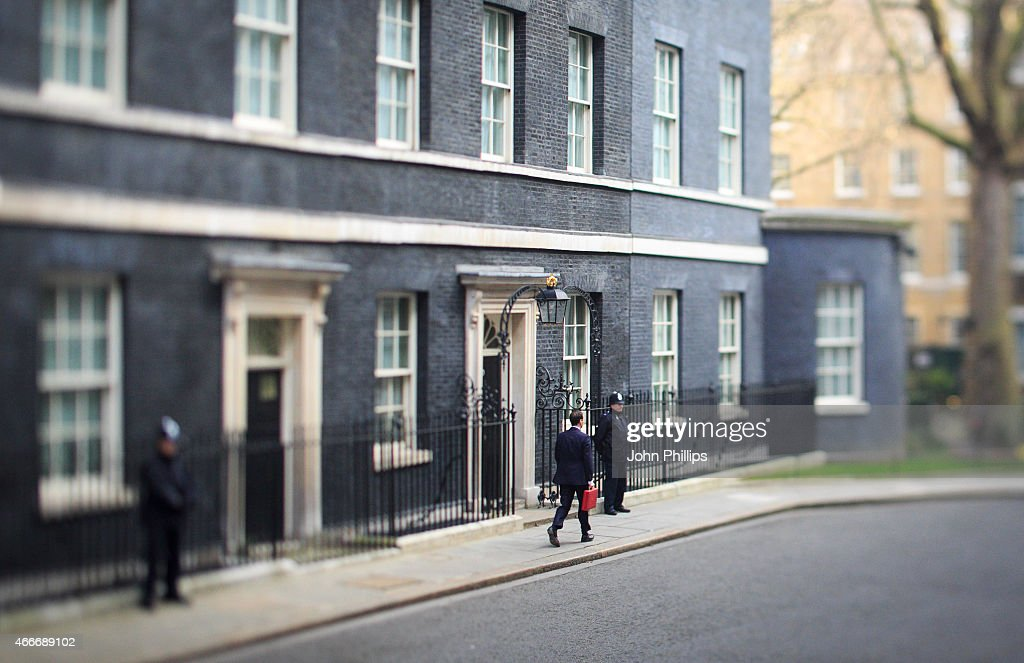 Chancellor of the Exchequer George Osborne leaves number 11 Downing Street for Parliament on March 18, 2015 in London, England. The Chancellor is presenting his 5th Budget to Members of Parliament today, the last before the General Election on May 7, 2015. at 11 Downing Street on March 18, 2015 in London, England.