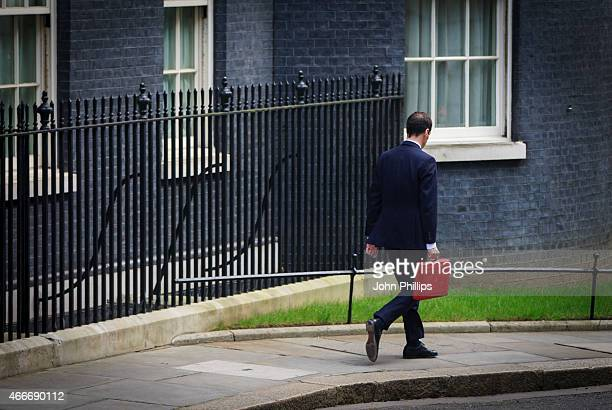 Chancellor of the Exchequer George Osborne leaves number 11 Downing Street for Parliament on March 18 2015 in London England The Chancellor is...
