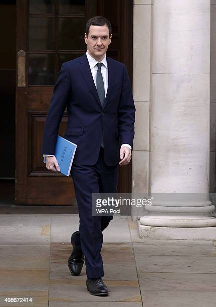 Chancellor of the Exchequer George Osborne leaves the Treasury for the House of Commons to deliver the his Autumn statement on November 25 2015 in...