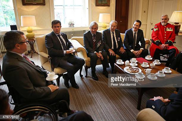 Chancellor of the Exchequer George Osborne meets with Victoria Cross and George cross medal winners during a reception at 11 Downing Street on July 7...
