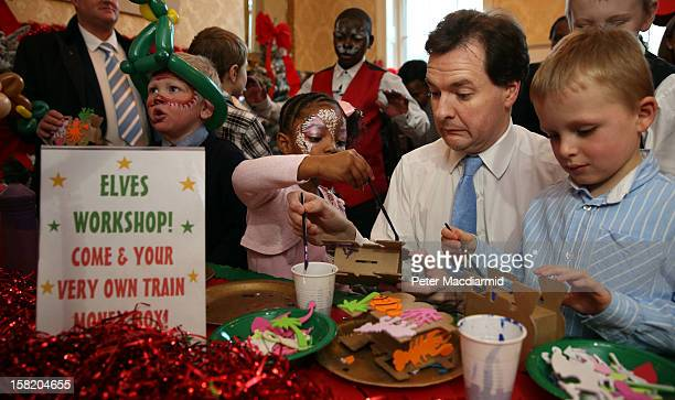 Chancellor of the Exchequer George Osborne paints a money box with children at Number 11 Downing Street on December 11 2012 in London England The...