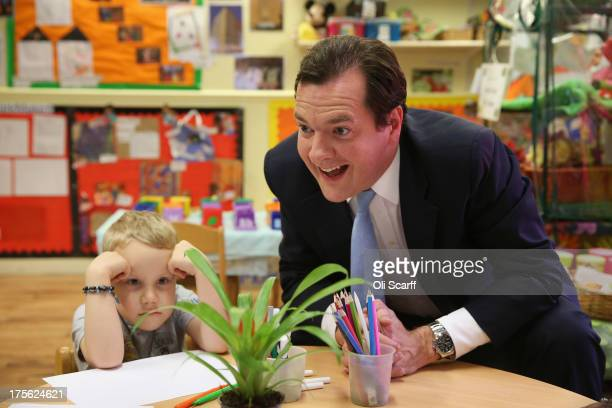 Chancellor of the Exchequer George Osborne plays with Titas during a visit to a nursery in Hammersmith on August 5 2013 in London England During his...
