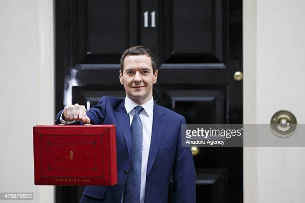 Chancellor of the Exchequer George Osborne poses for photographers outside 11 Downing Street in London England before presenting his summer budget to...