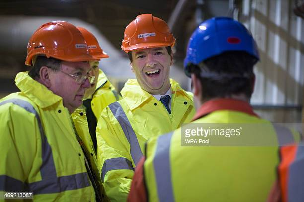 Chancellor of the Exchequer George Osborne smiles during a visit to BSW Timber in Cargo on February 13 2014 in Carlils United Kingdom In a speech...
