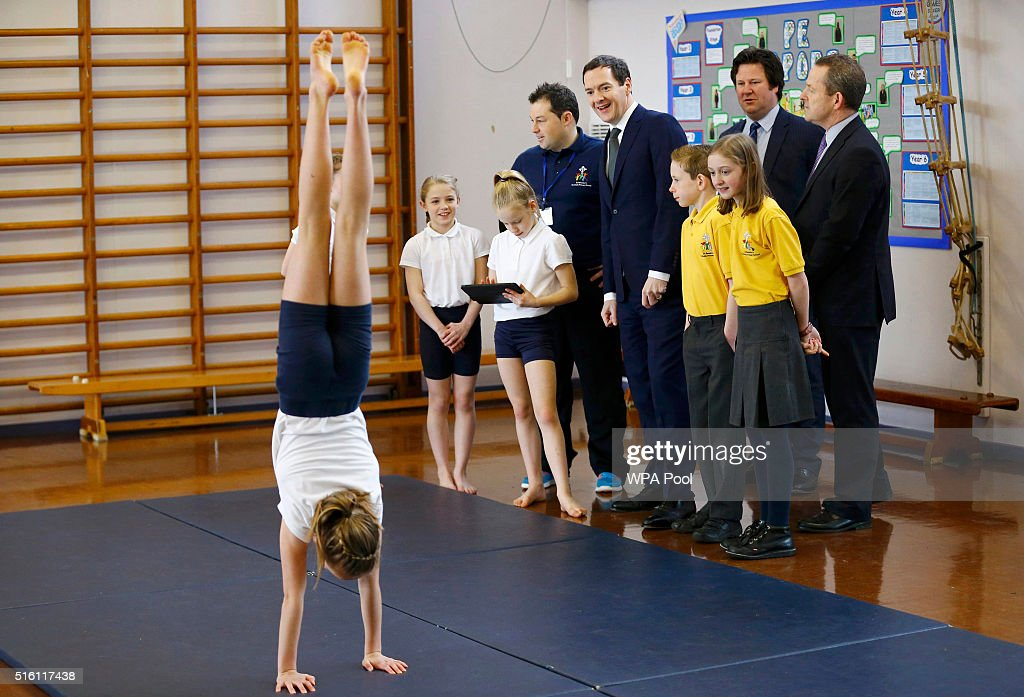 Chancellor of the Exchequer George Osborne speaks to pupils during a gymnastics lesson at St Benedict's Catholic Primary School on March 17, 2016 in Garforth, United Kingdom. The Chancellor announced in his Budget speech yesterday that all schools in England will become academies by 2020.