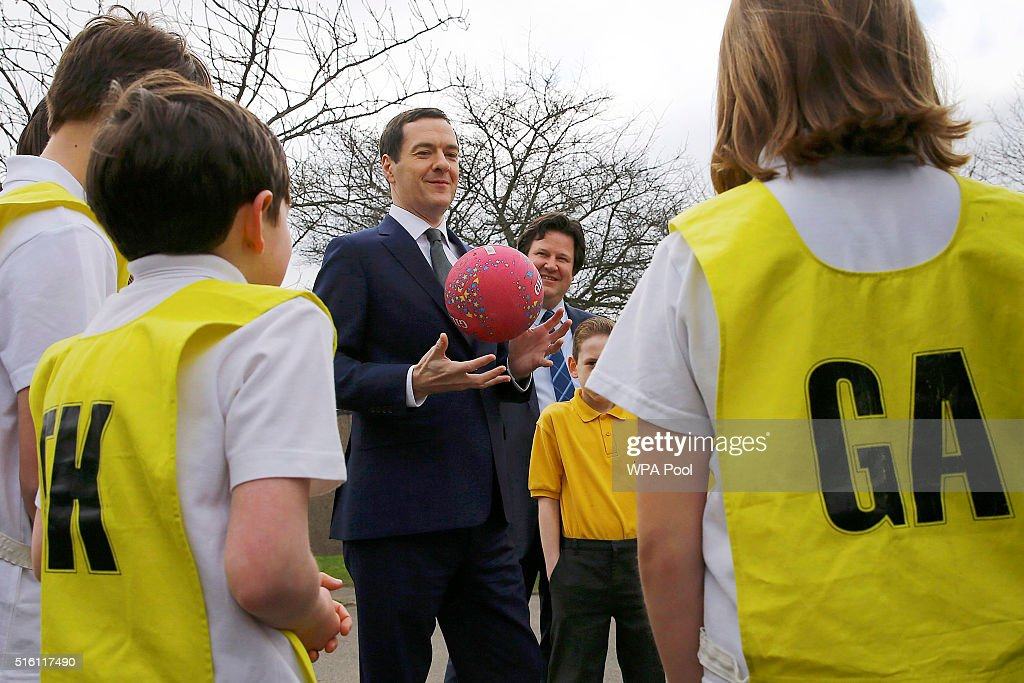Chancellor of the Exchequer George Osborne speaks to pupils during a netball lesson at St Benedict's Catholic Primary School on March 17, 2016 in Garforth, United Kingdom. The Chancellor announced in his Budget speech yesterday that all schools in England will become academies by 2020.