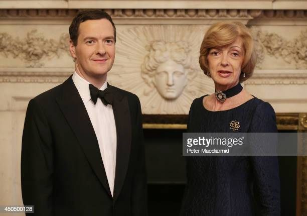 Chancellor of the Exchequer George Osborne stands with Lord Mayor of the City of London Fiona Woolf at the 'Lord Mayor's Dinner to the Bankers and...