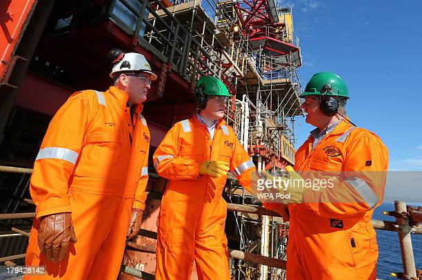 Chancellor of the Exchequer George Osborne talks with Talissman Senior Vice President Geoff Holmes and worker Ian Charles during his visit at the...