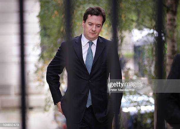 Chancellor of the Exchequer George Osborne walks into Downing Street on October 18 2010 in London England Bosses of 35 of the UK's largest companies...