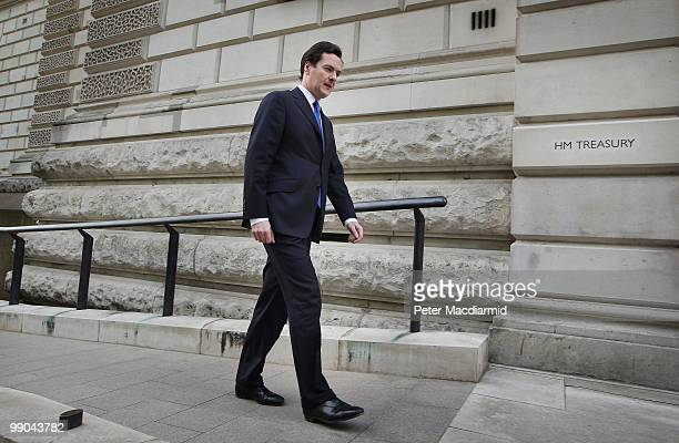 Chancellor of The Exchequer George Osborne walks to the treasury on May 12 2010 in London England After a tightly contested election campaign and...